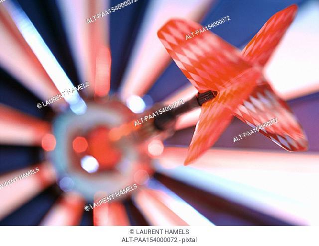 Dart in bulseye of dartboard, close-up