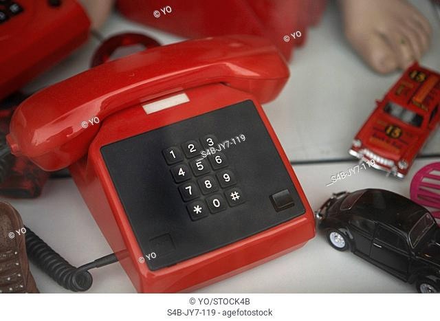 Outdated telephone and toy cars