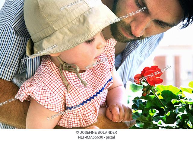 Father daughter and a flower Sweden