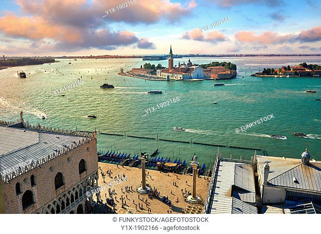 Arial view form St Mark's Campinale of St Mark's Square and the Doges with the island of San Giorgio Maggiore behind , with its church front designed by Andrea...
