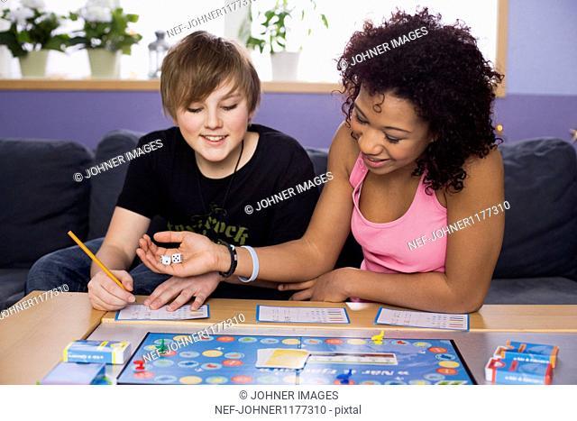 Teenage girl and boy playing leisure game