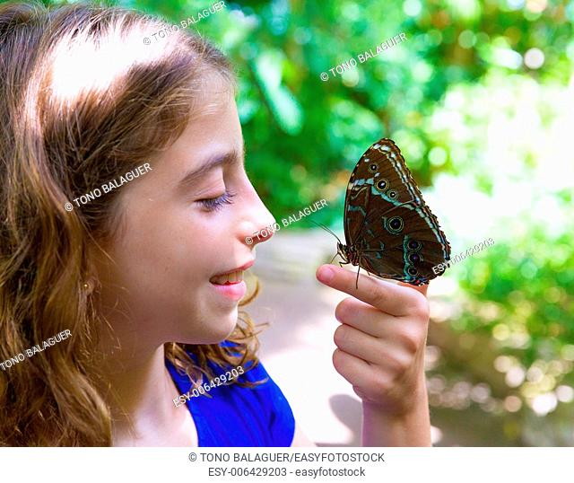 Girl holding finger Blue Monrpho Butterfly Peleides inoutdoor park