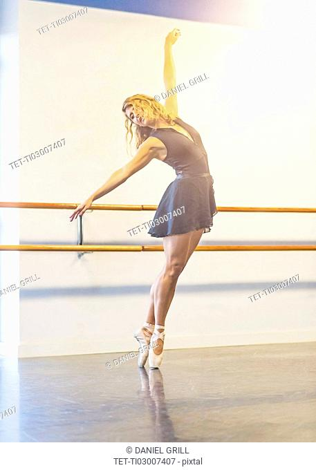 Young woman dancing in dance studio