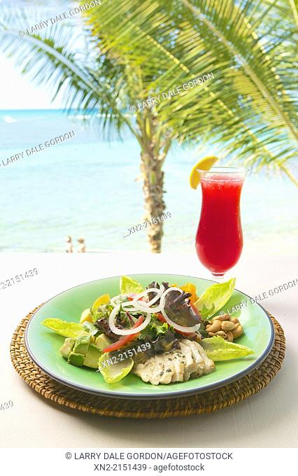 Chicken salad and cranberry juice cocktail served al fresco at the beach in Honolulu, Hawaii, United States