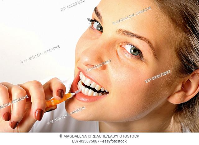 Girl using Interdental Brush for teeth hygiene