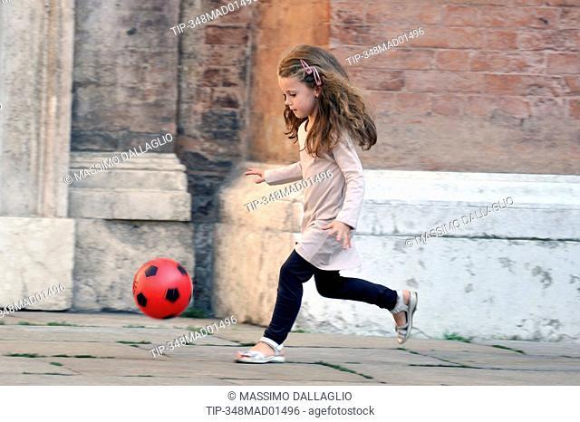 Little girl run with ball