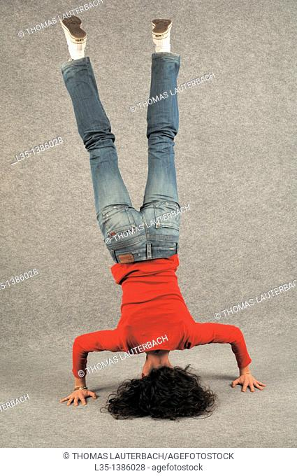 Young woman doing a headstand
