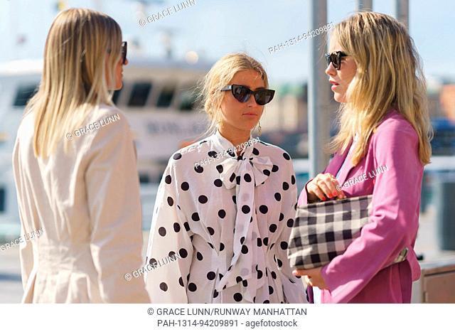 Blogger Celine Aagaard, stylist Emili Sindlev, and Annabel Rosendahl waiting outside the Stylein runway show during Stockholm Fashion Week - Aug 30