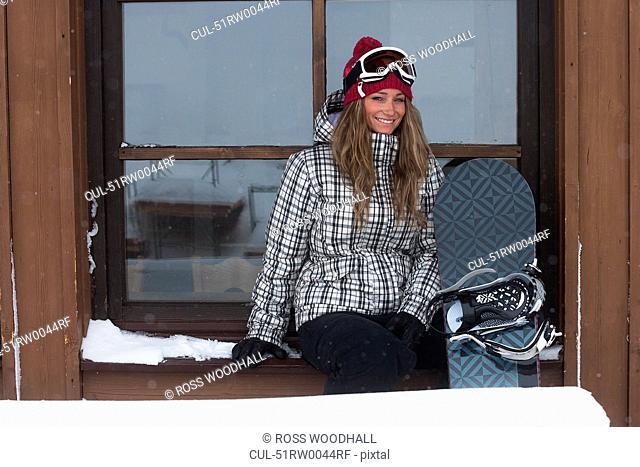 Snowboarder sitting in window