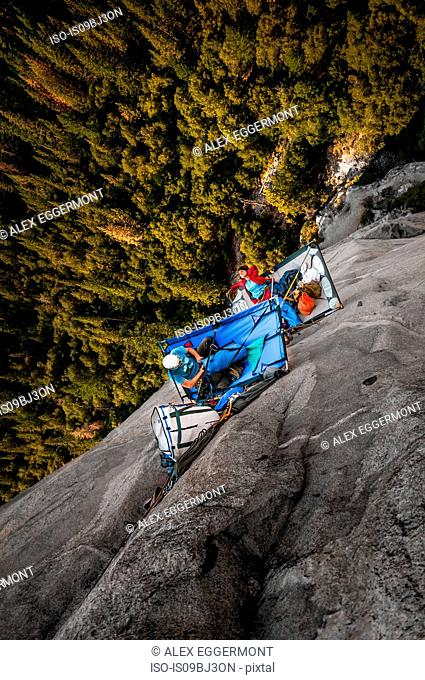 Two rock climbers on portaledges on triple direct, El Capitan, overhead view, Yosemite Valley, California, USA