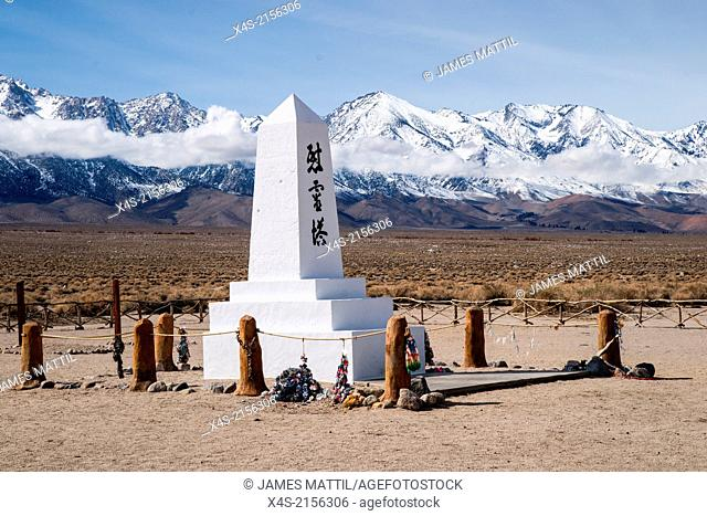 Memorial to Japanese-Americans interned at Manzanar relocation camp during WW-II stand in contrast to the freedom symbolized by Mt