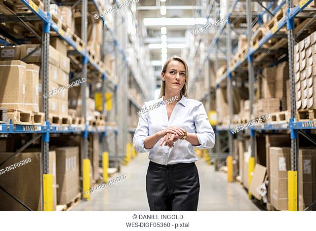 Woman in factory storehouse looking around