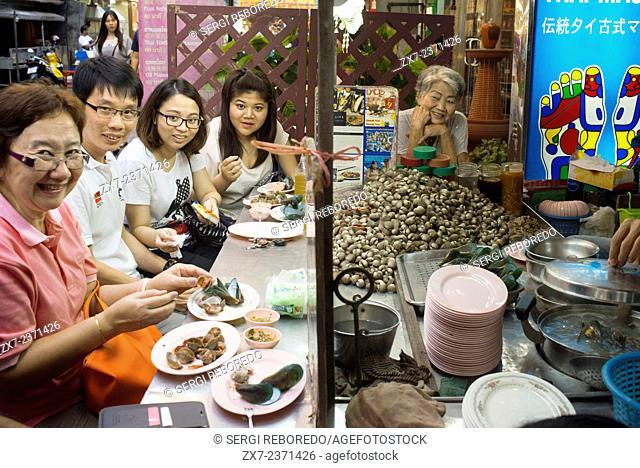 Restaurants in Thanon Yaowarat road at night in central Chinatown district of Bangkok Thailand. Yaowarat and Phahurat is Bangkok's multicultural district