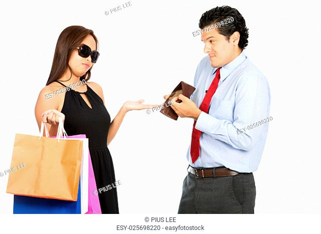 A greedy shopaholic gold digger stylish Asian wife demanding money for shopping from her poor sympathetic husband showing his empty wallet with no money