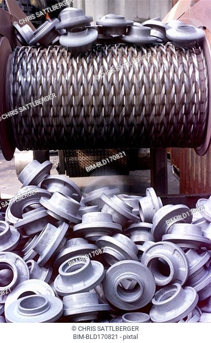 Plastic manufactured pieces on conveyor belt