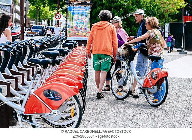 Colourful rental bicycle parking. Nantes, Brittany, France