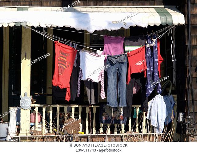 Laundry is washed clothing hanging on a line on a porch in Greenfield. Massachusetts, USA