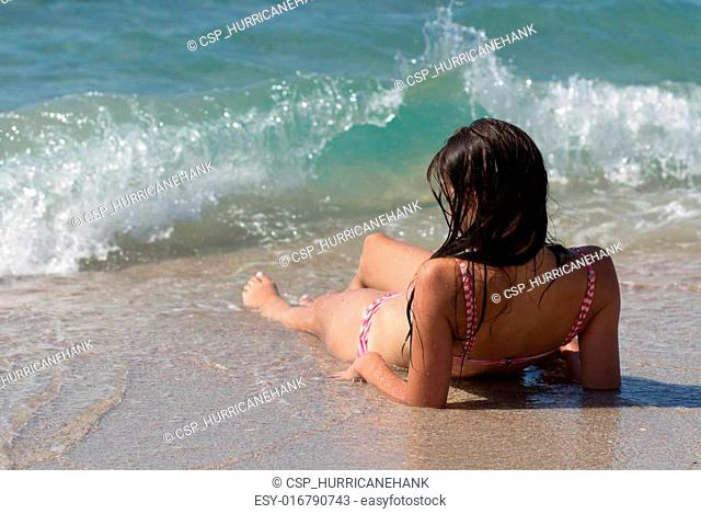 Young girl sunbathing at a resort