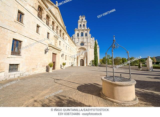 perspective of facade of Monastery Santa Maria de la Vid, church and water well, landmark and monument in Burgos, Castile and Leon, Spain, Europe