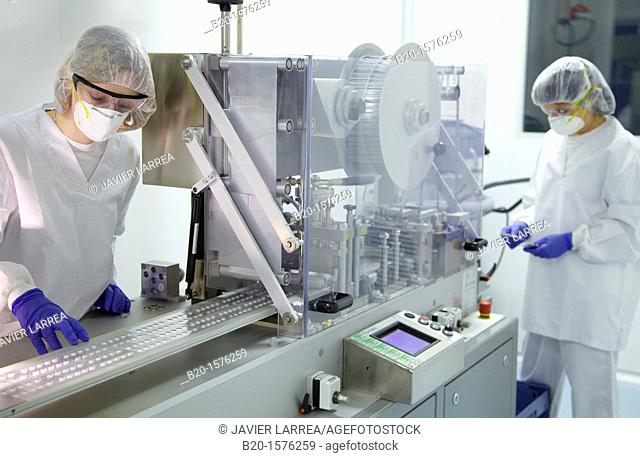 Technicians performing in-process control of tablets in a blister packaging, Clean room, Pharmaceutical plant, Drug manufacturing plant, Research Center