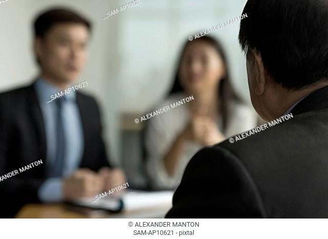 Singapore, Three business people talking at desk