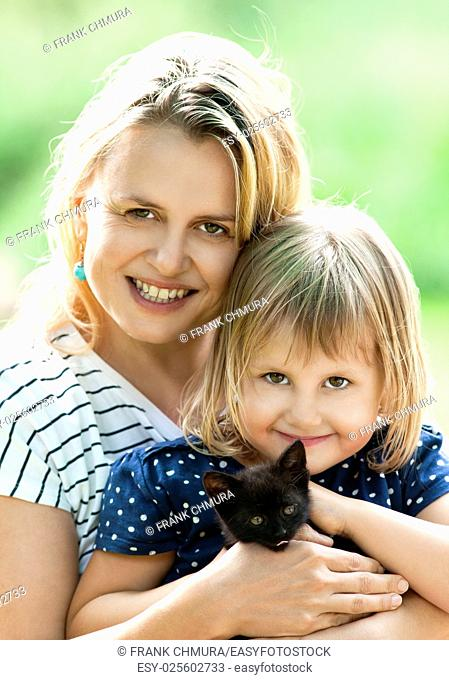 Portrait of a Mother and Daughter with a Kitten
