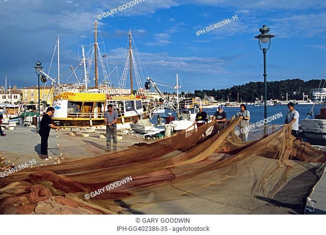 Croatia - Fishermen sorting nets on the quayside in the resort of Rovinj