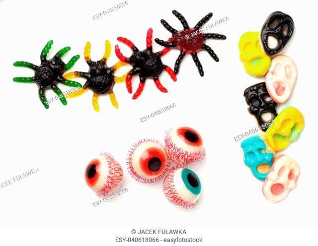 Halloween gummy candies isolated on white background. Top view