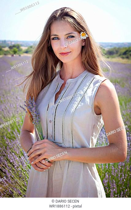Young Women With Flower in Hair Standing In Lavender Field, Croatia, Dalmatia, Europe