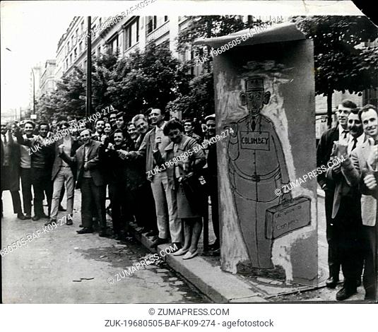 May 05, 1968 - Au'voir De Gaulle, Adieu Charlot'. Parisians with a poster drawing which points the way they want de Gaulle to go