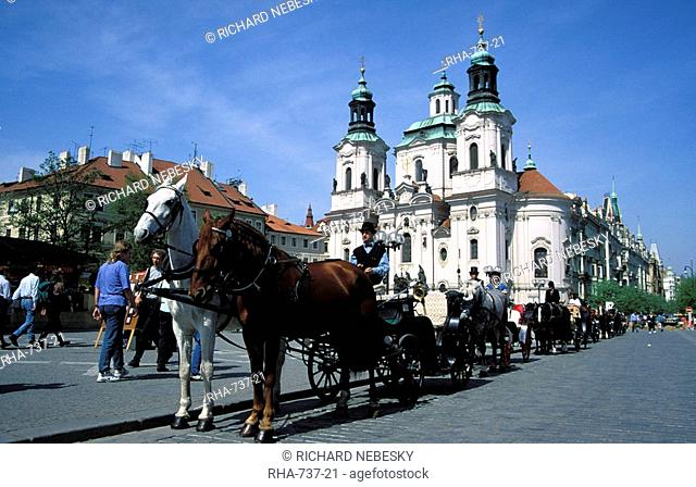 Horse drawn carriage at Old Town Square and St. Nicholas church, Stare Mesto, Prague, Czech Republic, Europe