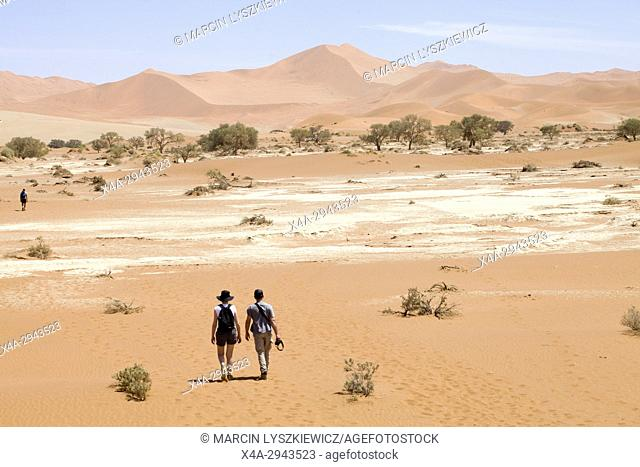 A young couple walking on the desert
