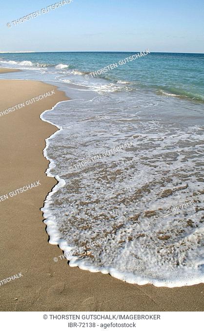Deserted lonely beach in the early season El Vendrell, Coma Ruga Costa Dorada Spain