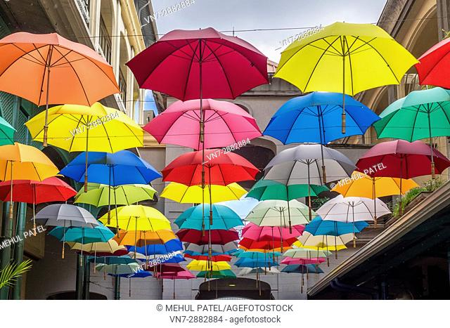 Street art display, hanging umbrellas, Caudan Waterfront, Port Luis, Mauritius. Caudan Waterfront is a commercial centre in Port Luis