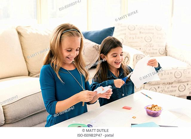 Girls at home doing arts and crafts