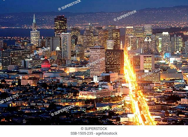 High angle view of a city lit up at dusk, San Francisco, California, USA