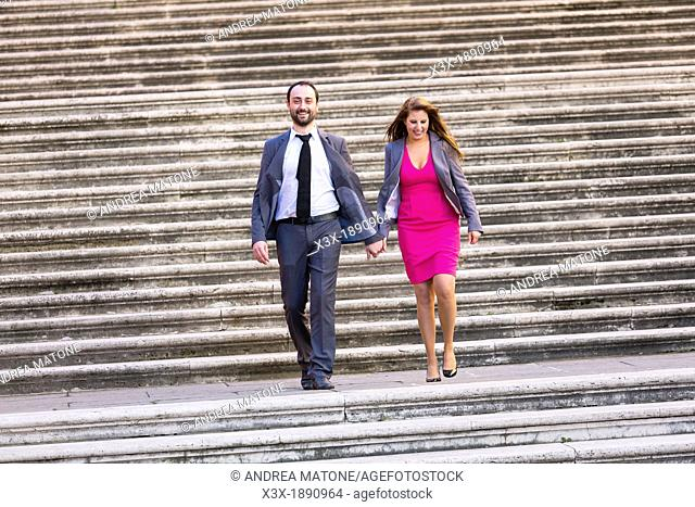 Engagement couple walking on stairs in Rome Italy