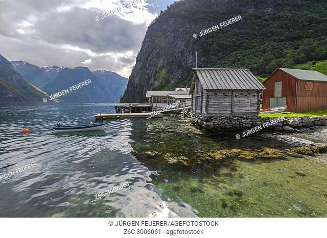 fjord, mountains and wooden boathouse in mystic light, Norway, seashore of Undredal, Aurlandsfjorden, municipality of Aurland, Sognefjord
