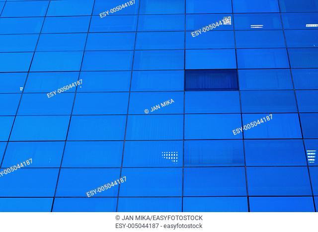 Blue windows of skyscraper office building background