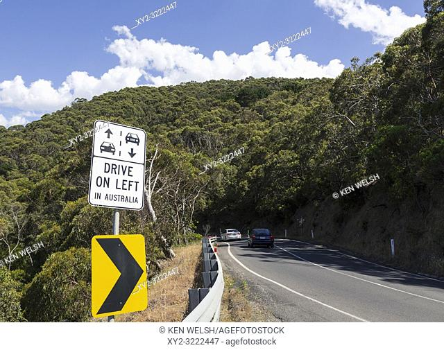Warning to foreign tourists that in Australia they must drive on the left. Photographed on the Great Ocean Road, Victoria, Australia