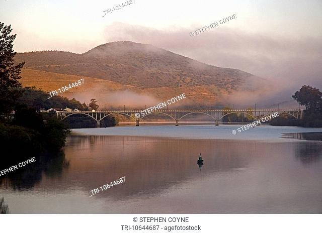 SPAIN, River Douro, Vega Terron, view of the bridge and hillside in the mist