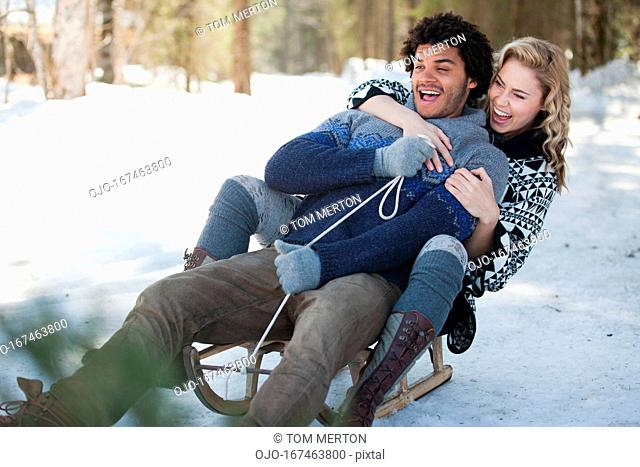 Man and woman on sled