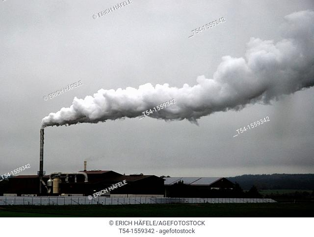 Vapor cloud of a food dryer from rain sky