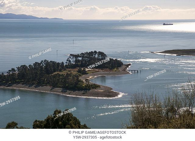 Looking out over the harbour with Tasman Bay and the western ranges beyond, from above Nelson, New Zealand. Haulashore Island at left and to its right