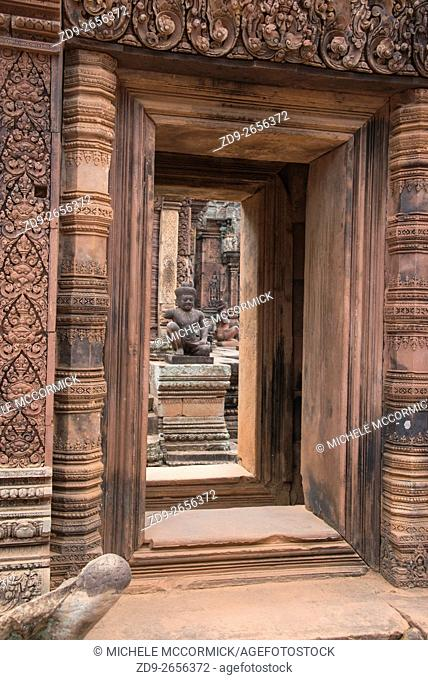 The ancient pink stones distinguish the temple at Banteay Srey near Siem Reap