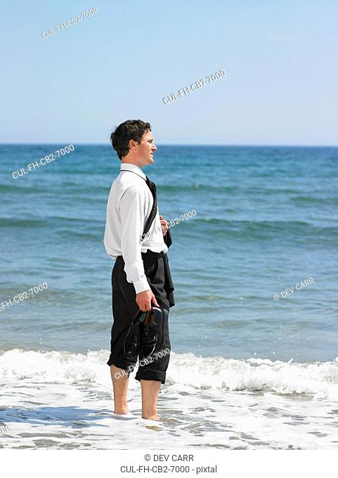 Businessman at the beach