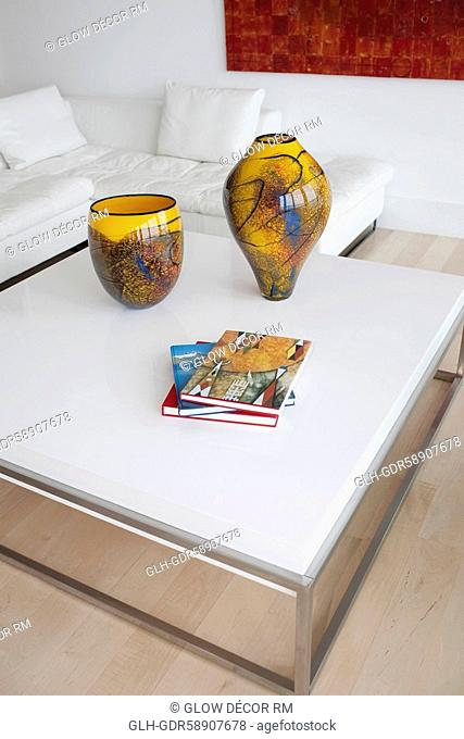 Decorative urns and magazines on a table
