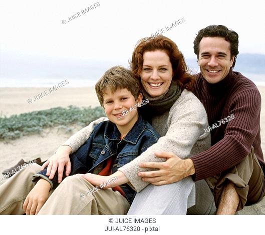 Portrait of a family posing for the camera on a beach