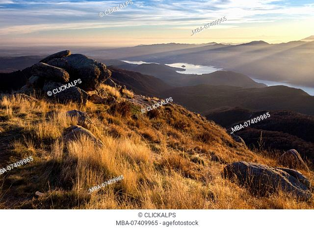 View of the Monte Rosa and Lago d'Orta from a group of rocks at the top of Mottarone at sunset. Stresa, Verbano Cusio Ossola, Piedmont, Italy
