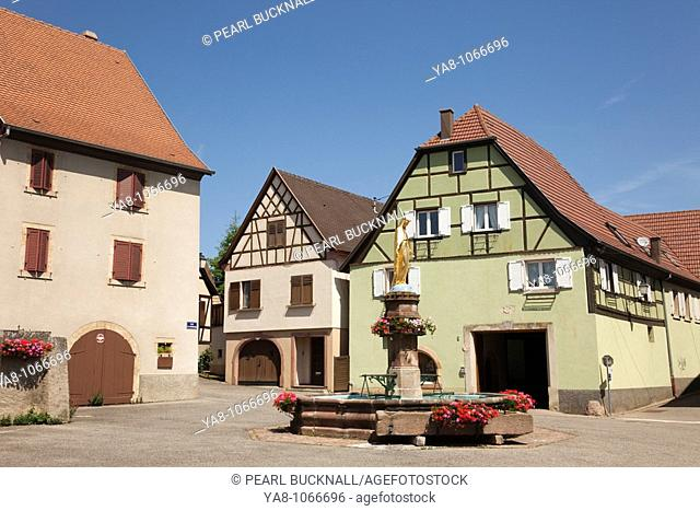 Obermorschwihr, Alsace, France, Europe  Fountain and statue in medieval village on wine route  A commune in the Haut Rhin department in Alsace